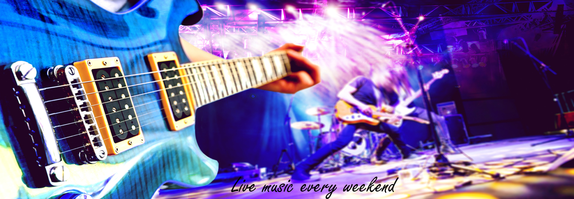 Live music and concert background. Guitarist and drummer and singer.Night entertainment and festival events.