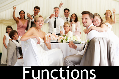 Bride And Groom Celebrating With Guests At Reception